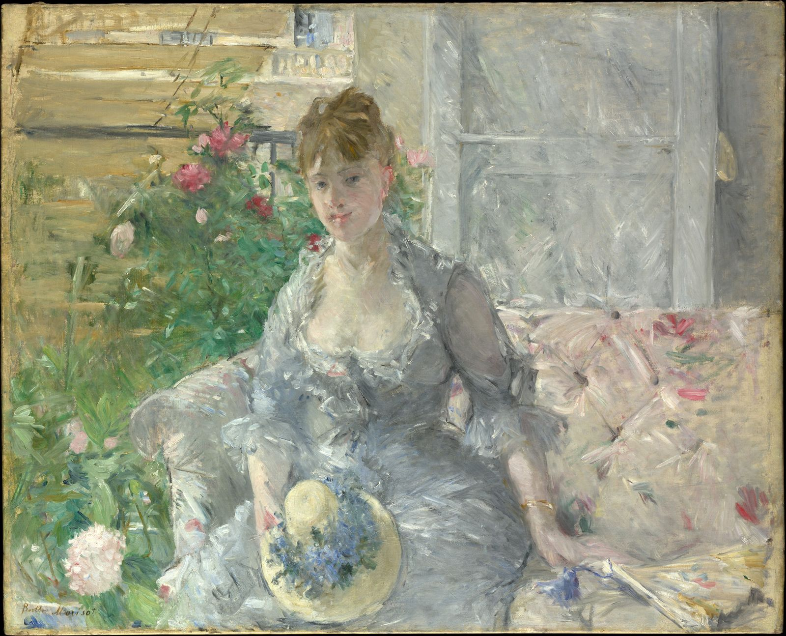 Young Woman Seated on a Sofa.jpg