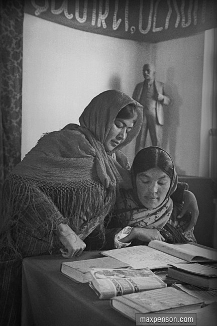 two-women-reading-book-at-v-i-lenins-bust.jpg