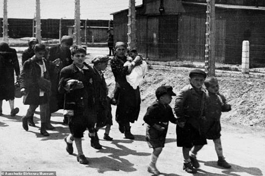 38534456-9191921-Their_faces_etched_with_fear_Jewish_children_and_mothers_carryin-a-13_1611740615123.jpg