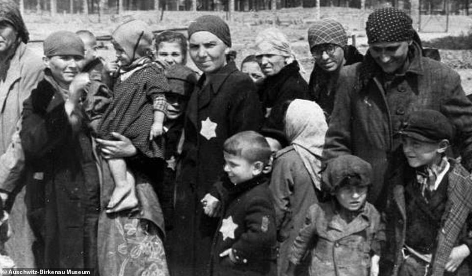 38534466-9191921-These_Hungarian_Jewish_women_and_children_are_seen_looking_at_th-a-47_1611743151954.jpg