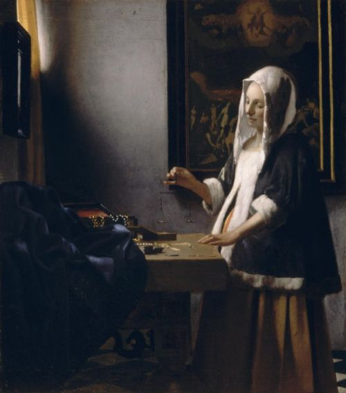 woman_holding_a_balance_vermeer
