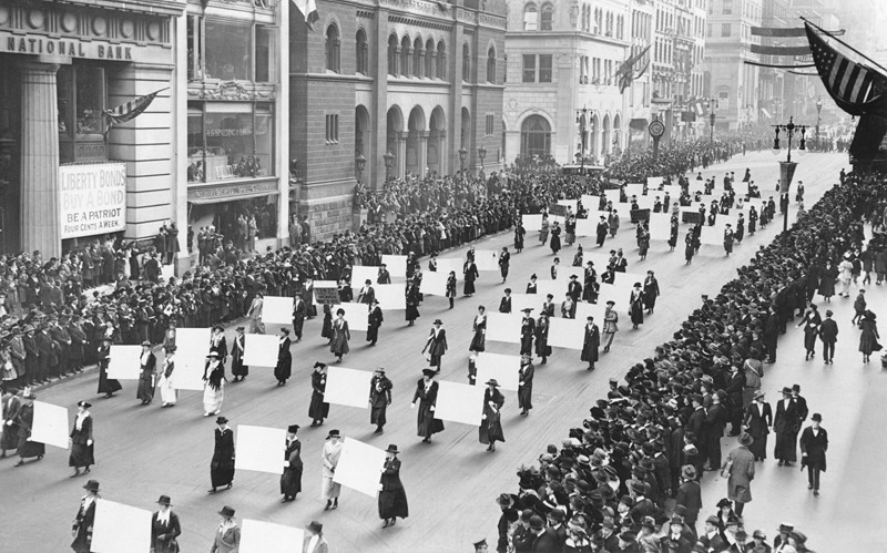 Suffragists parade down Fifth Avenue, 1917.Advocates march in October 1917, displaying placards containing the signatures of more than one million New York women demanding the vote.The New York Times Photo Archives