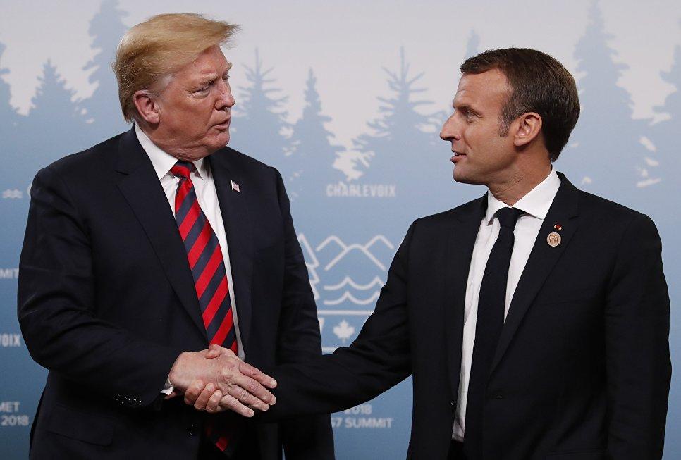 Рукопожатие президентов США и Франции Дональда Трампа и Эммануэля Макрона на саммите G7. 8 июня 2018 года