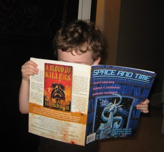 The Little Man, engrossed in the latest issue of Space and Time