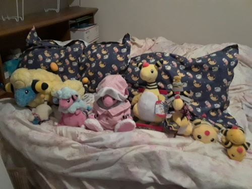 The Flaaffy pajamas from Pikachu's Closet don't fit the Flaffy plushies. I'm surprised they haven't fallen off, since I just put them on for the photo and they really, really, really do not fit.