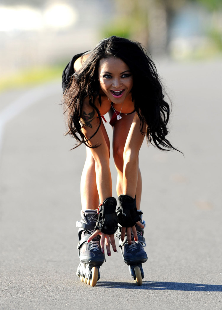 Beautiful blond sexy girl posing on a vintage roller in