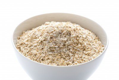 15874257-porridge-oats-dry-uncooked-in-a-white-bowl