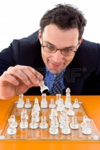 2538877-chessman-playing-checkmate-on-glass-board