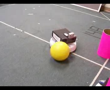 robot behind a yellow ball