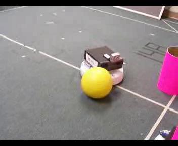 robot behind a yellow ball