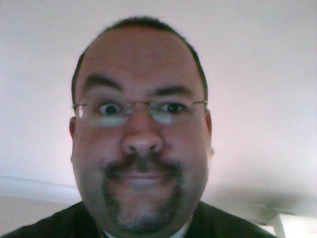 Me, glasses on, new hair cut, taken on Eee
