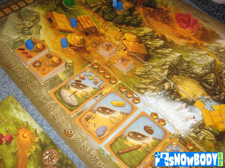 Настольная игра Stone Age - партия в самом разгаре. Сейчас синие будут делить ништяки