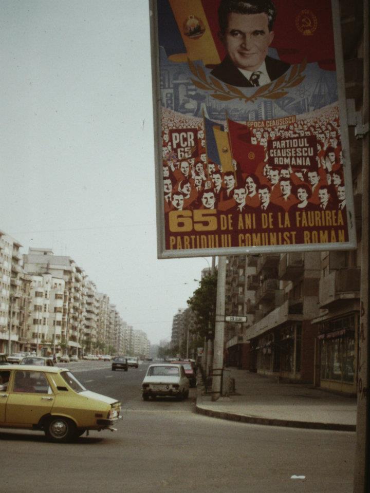 A propaganda poster on the streets of Bucharest, 1986.jpg