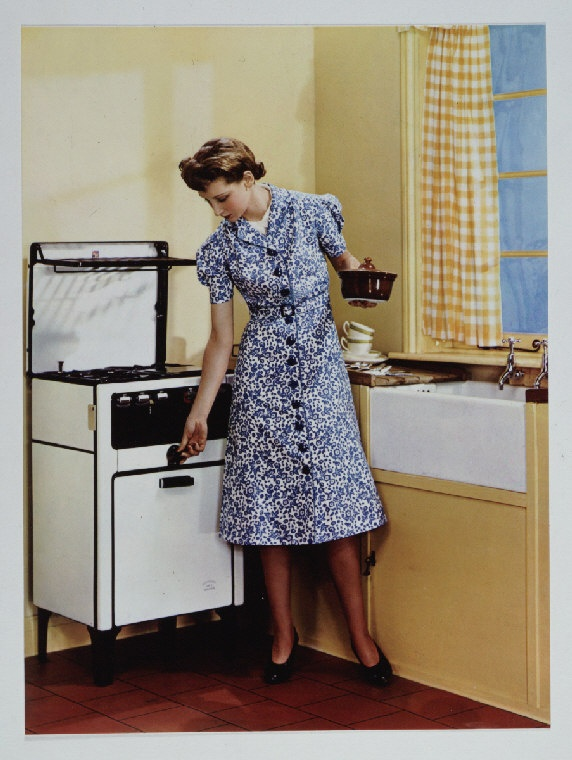 1935c woman in a kitchen, taken by an unknown photographer.jpg