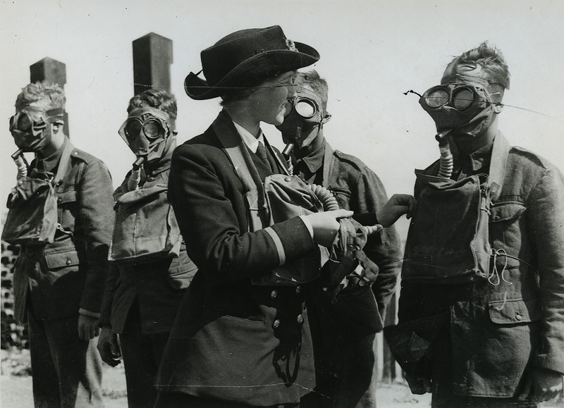 W.R.N.S. instructor at respirator and mask drill for military recruits