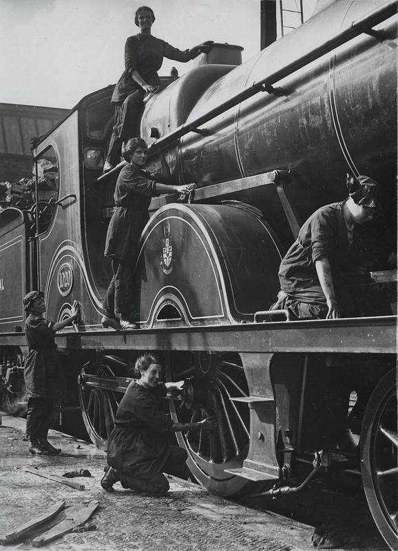 British women cleaning locomotive in Midlands
