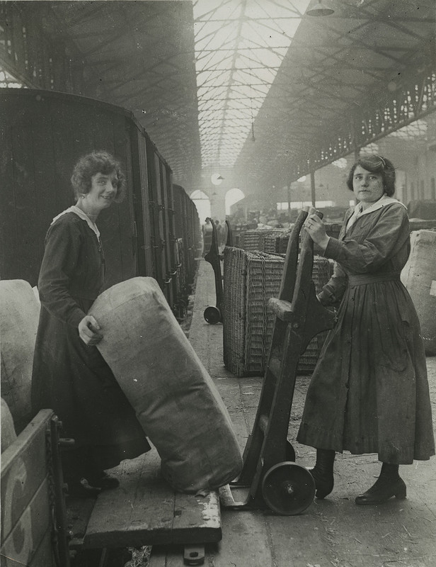 Railway workers unloading goods from train