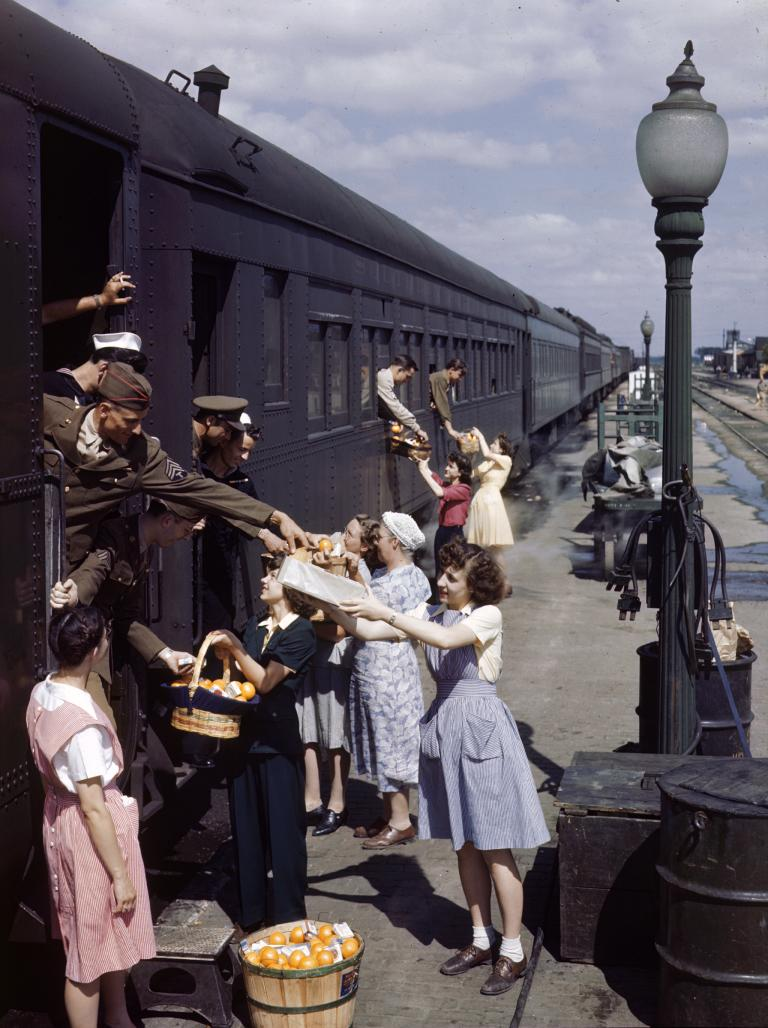 Farm women give fresh produce to traveling serviceman in North Platte, Nebraska. This photo appeared in a 1945 issue of National Geographic..jpg