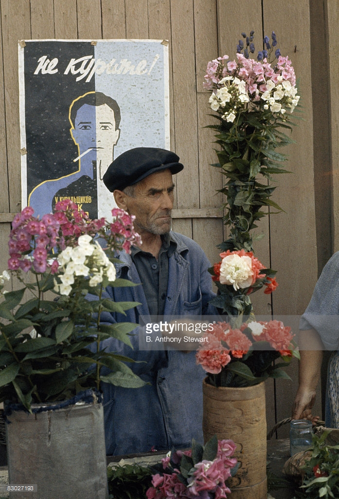 1959 A flower vendor arranges vases of bouquets by an anti-smoking poster, Moscow by B. Anthony Stewart.jpg