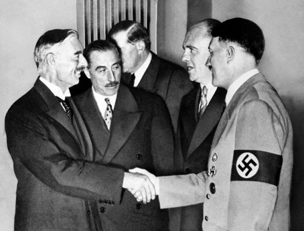 Adolf Hitler and British Prime Minister Neville Chamberlain shake hands 1938
