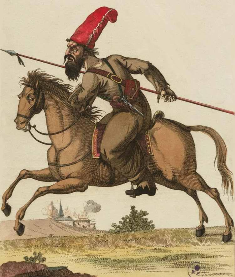 Сибирский казак с пикой скачет на коне