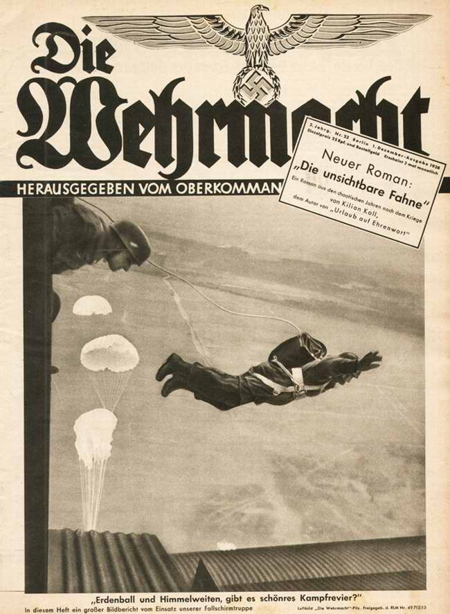 Немецкие парашютисты в момент выброски из самолета