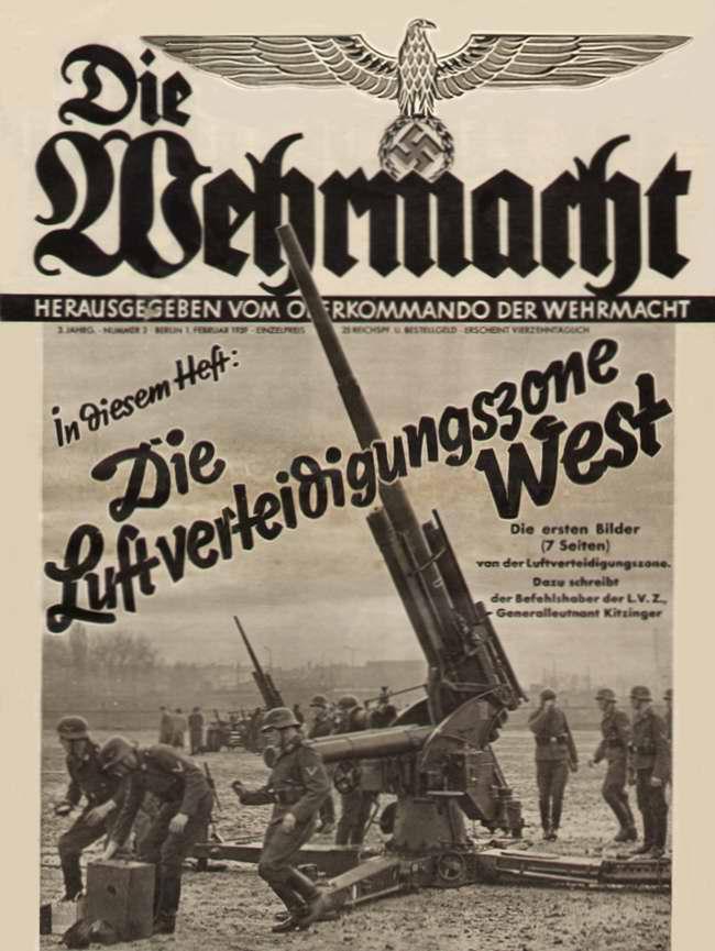 Разворачивание батареи зенитных орудий возле одного из промышленных немецких городов накануне начала оккупации Чехии