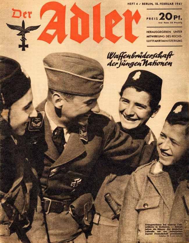 Братство по оружию с итальянской молодежью: юные помощники зенитчиков дружески общаются с немецким офицером люфтваффе