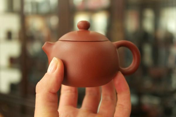 Yixing teapot in my fingers