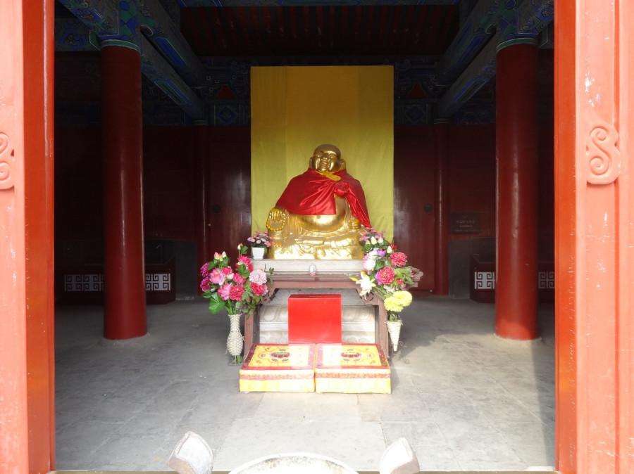 Довольный Будда