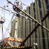 A pirate ship between big buildings.
