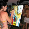 artist inspired by the music, painting during the show