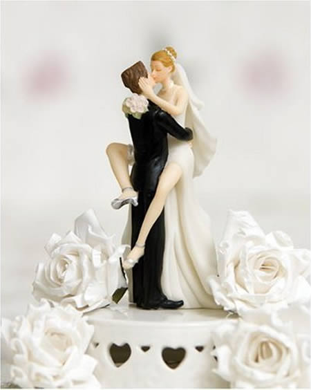 even-today-placing-funny-wedding-cake-toppers-on-a-wedding1