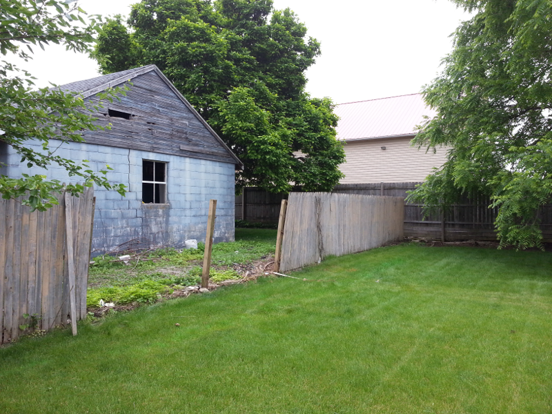 The fence guys start taking the old fence down.