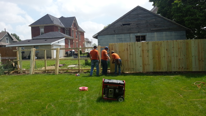 The fence dudes installing the new fence!