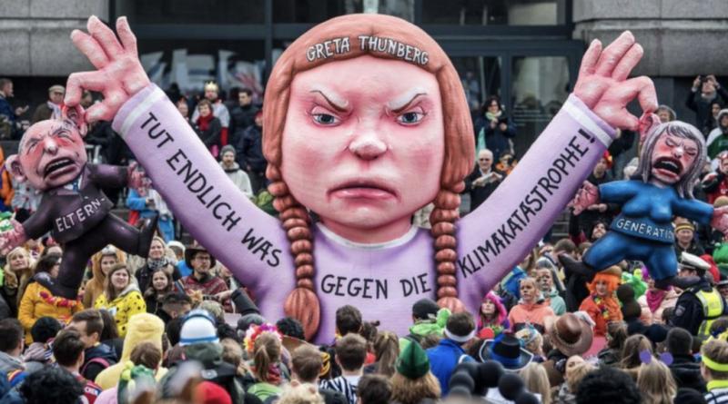 """Иконостас новой религии и ее паства. Гигантский balloon  """"Сердитая Грета"""" держит в руках крошечные фигурки мужчины и женщины, символизирующие поколение  ее родителей. То есть, тех, кто """"украл ее детство, ее мечты, ее жизнь""""."""
