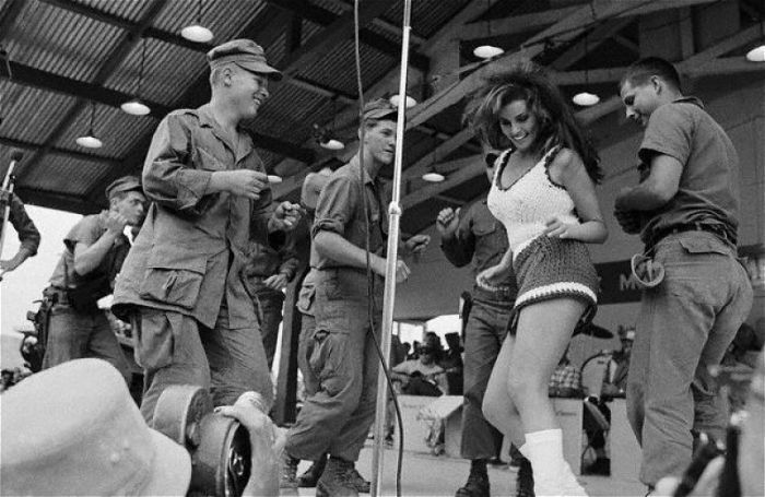 Raquel Welch, shaking it in a knit mini for troops at a USO show, Oct 1967 (AP) .