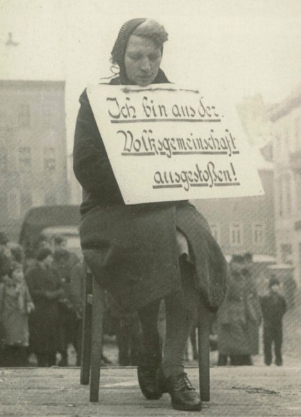 German woman with shield  I am Expelled from the people s community Altenburg (Thuringia) 7 Feb 1942 because she was together with a Pole.