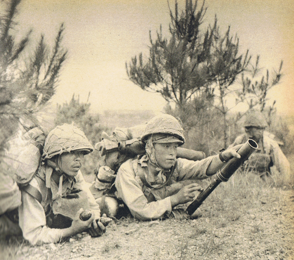 Japanese 13th Army operating a Type 89 grenade launcher, Jinhua, Zhejiang  China 30 May 1942