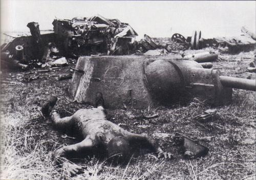 Dead Russian TankerOn a battlefield near Orel, the burned corpse of a Russian soldier lies next to the turret of his bomb-blasted tank
