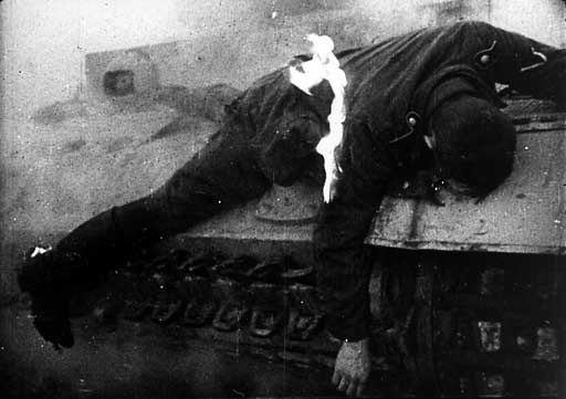 Killed by a German tank officer, Corporal, burning on the armor of his tank PzKpfw III.