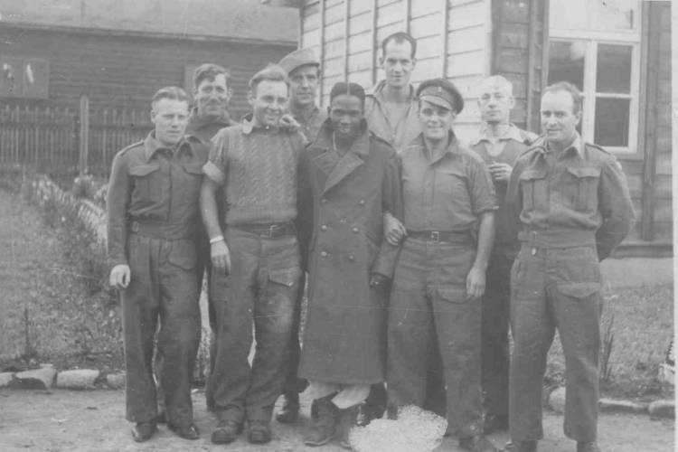Group of nine POWs in Stalag XVIIIA Germany. William tallest in the photograph.