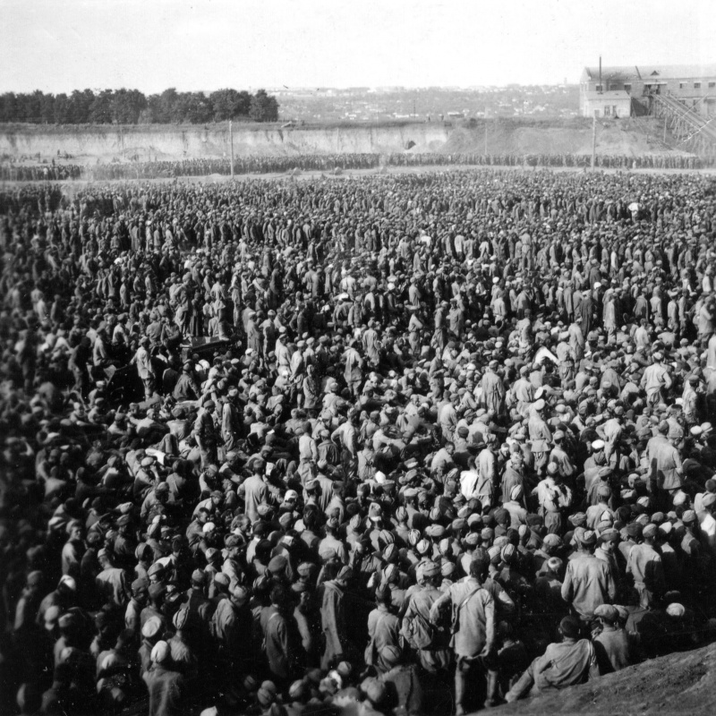"August 1941, the ""Pit of Uman"" - Stalag 349; an open-air camp containing in a brickyard quarry about 50,000 Soviet POWs from the ""Uman cauldron"". Most of them won't survive coming autumn and winter."