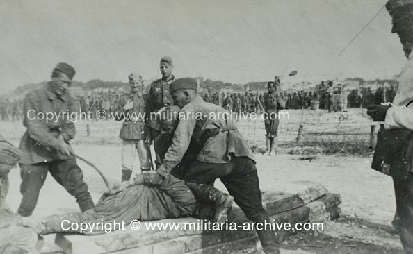 Телесные наказания военнопленого руками лагерных полицаев
