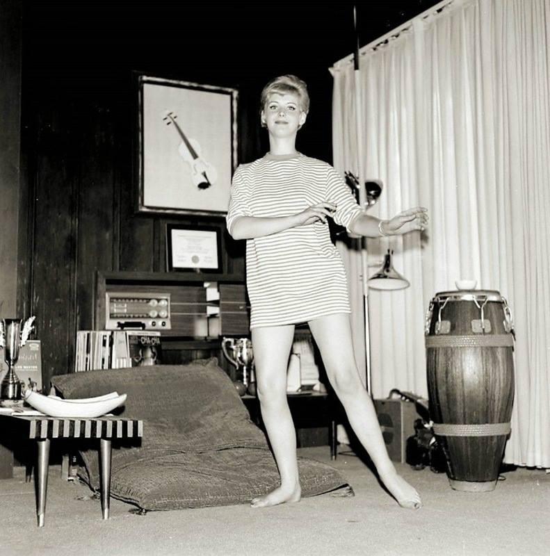 beatnik chick in her living room. 1959.