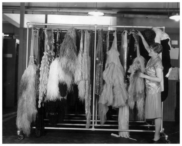 pan-assistant-hanging-a-clothes-rail-with-a-selection-of-evening-gowns-which-are-to-packed-away-for-the-holidays-photo-by-general-photographic-agency-getty-images-1927-dress-collectio-1