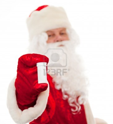 8325836-close-up-of-santa-claus-with-a-bottle-for-pills-isolated-on-white-sharpness-on-the-bottle-drive