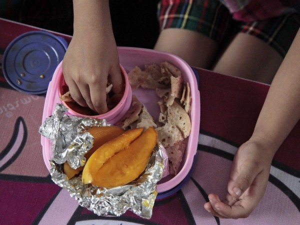 jammu-india-this-homemade-lunch-contains-flatbread-a-turnip-dish-and-mangoes