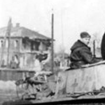 An assault gun of a SS mechanized div. crossin the railway aerea of Bjelgorod. End of march 1943 1