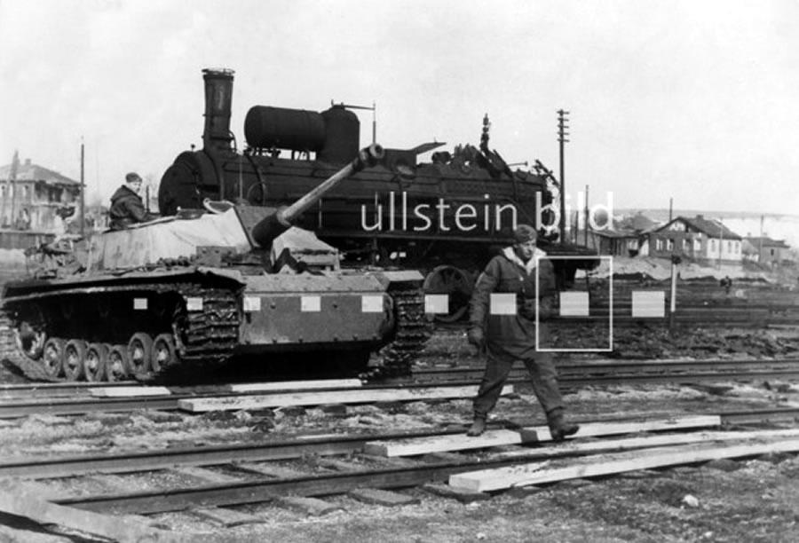 An assault gun of a SS mechanized div. crossin the railway aerea of Bjelgorod. End of march 1943